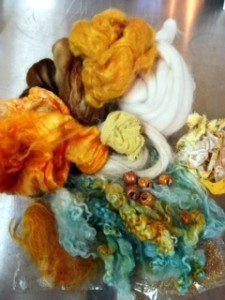 My package included a silk hankie, various fibers, locks, beads, fabric strips, and cheesecoloth