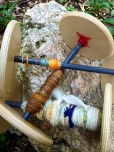 Three singles:  1.  silk thread, 2.  brown roving and 3. the art batt